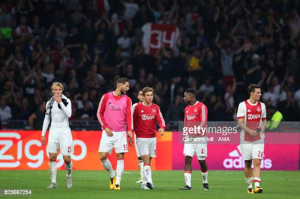 A dejected Ajax team at the end of the UEFA Champions League Qualifying Third Round match between Ajax and OSC Nice at Amsterdam Arena on August 2...