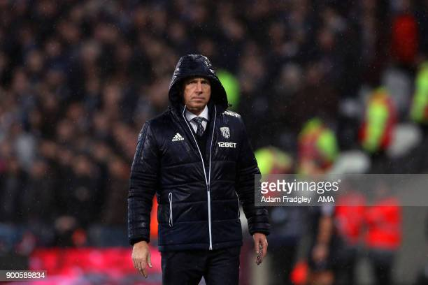 A dejected Alan Pardew head coach / manager of West Bromwich Albion during the Premier League match between West Ham United and West Bromwich Albion...