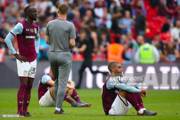 A dejected Albert Adomah of Aston Villa and Lewis Grabban of Aston Villa at full time during the Sky Bet Championship Play Off Final between Aston...