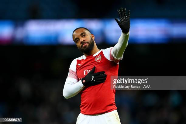 A dejected Alexandre Lacazette of Arsenal acknowledges the fans at full time during the Premier League match between Manchester City and Arsenal FC...