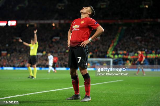 Dejected Alexis Sanchez of Man Utd during the UEFA Champions League Round of 16 First Leg match between Manchester United and Paris Saint-Germain at...
