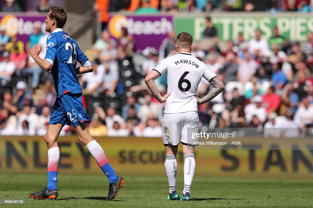 A dejected Alfie Mawson of Swansea City after Peter Crouch of Stoke City scores a goal to make it 1-2 during the Premier League match between Swansea City and Stoke City at Liberty Stadium on May 13, 2018 in Swansea, Wales.