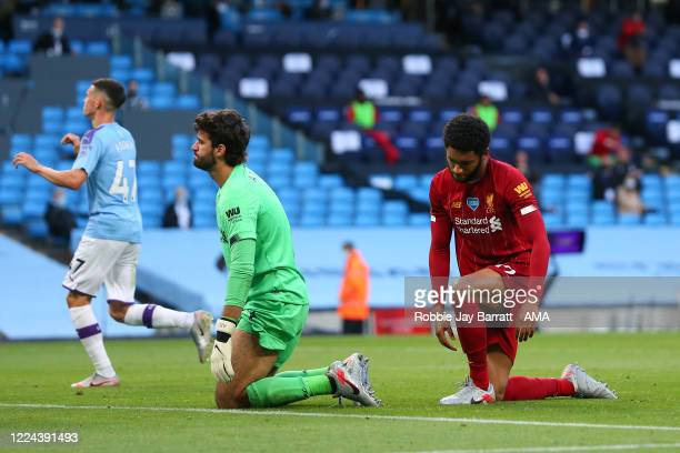 A dejected Alisson Becker and Joe Gomez of Liverpool after Raheem Sterling of Manchester City scored a goal to make it 20 during the Premier League...