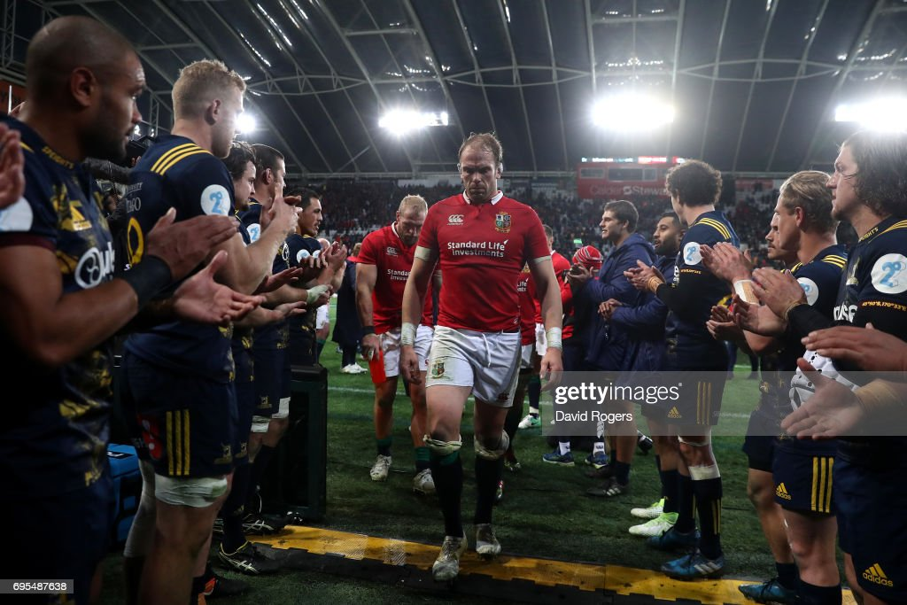 A dejected Alun Wyn Jones of the Lions and teammates walk off the pitch following their 23-22 defeat during the 2017 British & Irish Lions tour match between the Highlanders and the British & Irish Lions at the Forsyth Barr Stadium on June 13, 2017 in Dunedin, New Zealand.