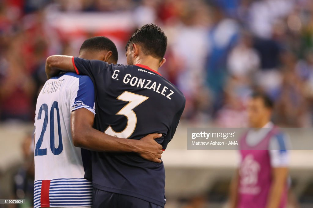 A dejected Aníbal Godoy of Panama is consolidated by Giancarlo Gonzalez of Costa Rica after losing 1-0 and being knocked out of the tournament during the 2017 CONCACAF Gold Cup Quarter Final match between Costa Rica and Panama at Lincoln Financial Field on July 19, 2017 in Philadelphia, Pennsylvania.