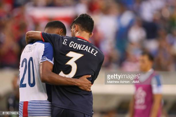 A dejected Aníbal Godoy of Panama is consolidated by Giancarlo Gonzalez of Costa Rica after losing 10 and being knocked out of the tournament during...