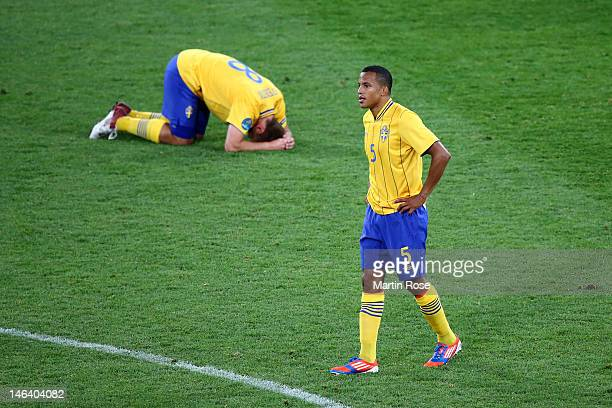 Dejected Anders Svensson and Martin Olsson of Sweden after defeat in the UEFA EURO 2012 group D match between Sweden and England at The Olympic...