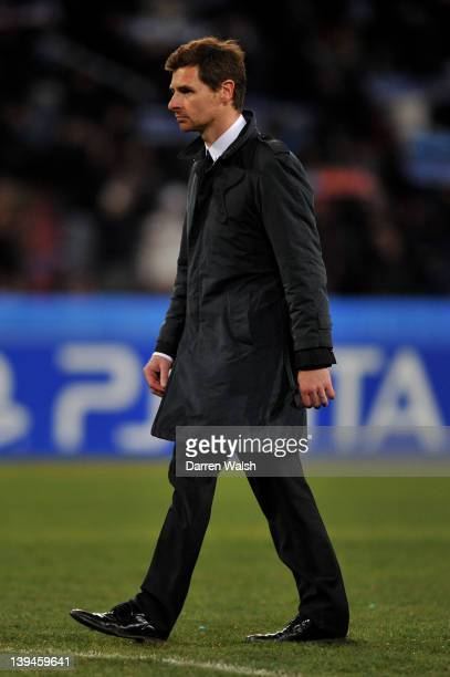 Dejected Andre Villas-Boas the Chelsea manager walks off the pitch following his team's 3-1 defeat during the UEFA Champions League round of 16 first...