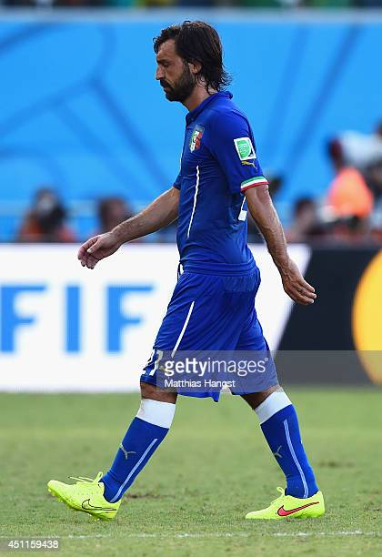 A dejected Andrea Pirlo of Italy walks off the pitch after a 10 defeat to Uruguay in the 2014 FIFA World Cup Brazil Group D match between Italy and...