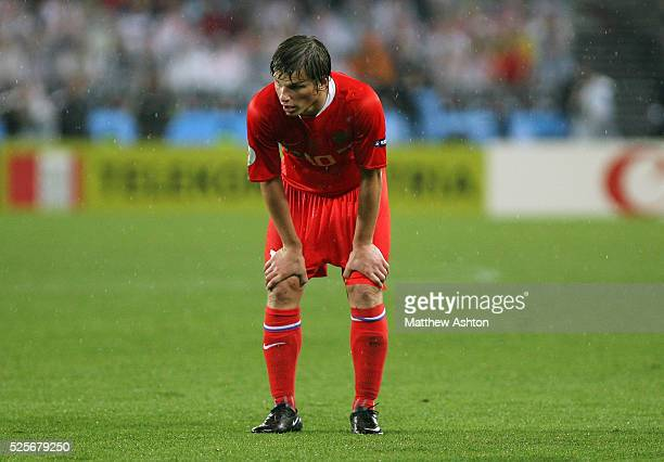 A dejected Andrei Arshavin of Russia stands with his hands on his knees during the UEFA EURO 2008 semifinal soccer match between Russia and Spain at...