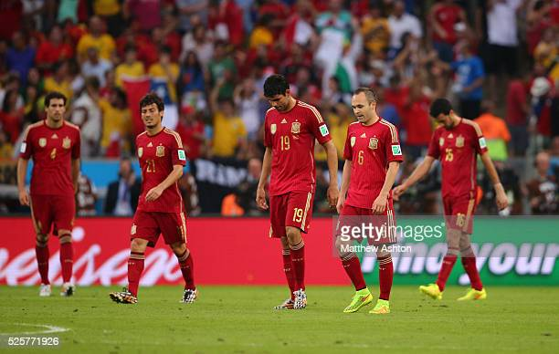 A dejected Andres Iniesta and Diego Costa of Spain lead the team back after Charles Aranguiz of Chile scores a goal to make it 02