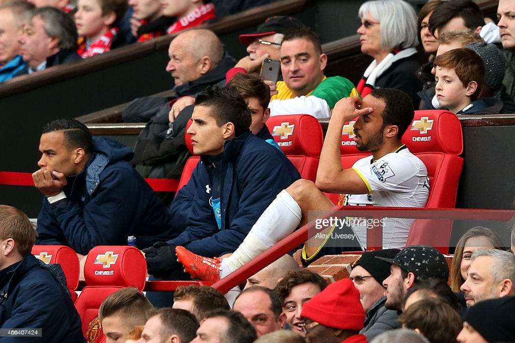A dejected Andros Townsend of Spurs holds his head in his hand after being substituted following a torrid first half during the Barclays Premier League match between Manchester United and Tottenham Hotspur at Old Trafford on March 15, 2015 in Manchester, England.
