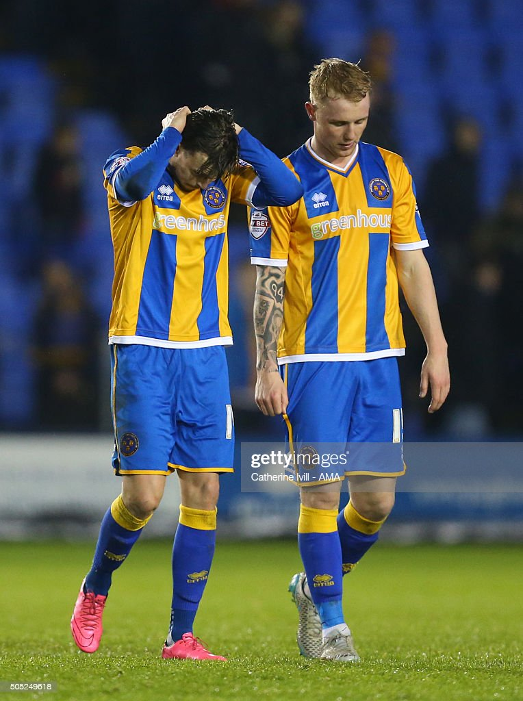 A dejected Andy Mangan and Jack Grimmer of Shrewsbury Town after the Sky Bet League One match between Shrewsbury Town and Barnsley at New Meadow on January 16, 2016 in Shrewsbury, England.