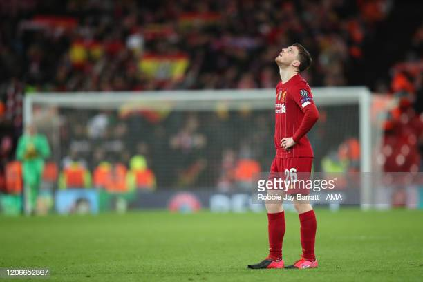Dejected Andy Robertson of Liverpool after defeat in the UEFA Champions League round of 16 second leg match between Liverpool FC and Atletico Madrid...