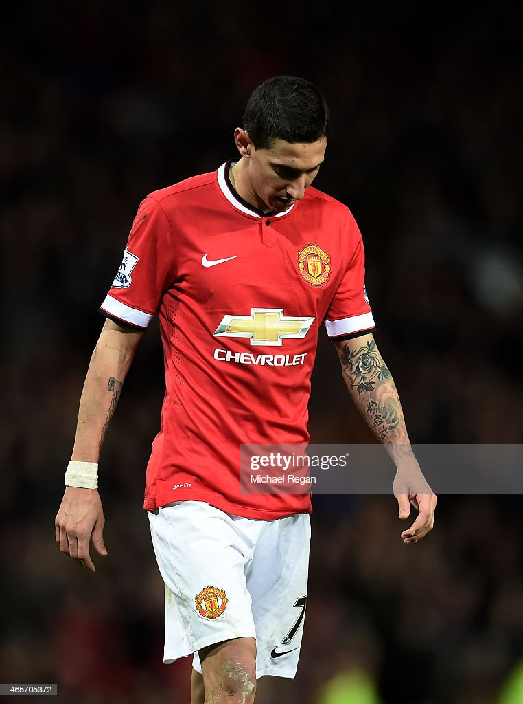 A dejected Angel di Maria of Manchester United walks off the pitch after receiving the red card from referee Michael Oliver during the FA Cup Quarter Final match between Manchester United and Arsenal at Old Trafford on March 9, 2015 in Manchester, England.