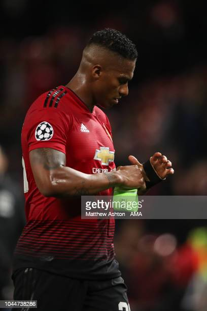 A dejected Antonio Valencia of Manchester United walks off the pitch at full time during the Group H match of the UEFA Champions League between...