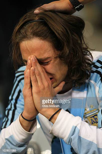 A dejected Argentina fan after being knocked out of the competition following the 2010 FIFA World Cup South Africa Quarter Final match between...