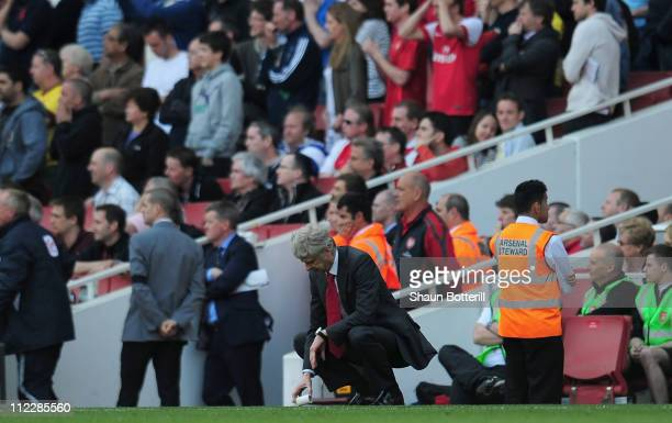 Dejected Arsenal manager Arsene Wenger after referee Andre Marriner awards Liverpool a penalty kick during the Barclays Premier League match between...