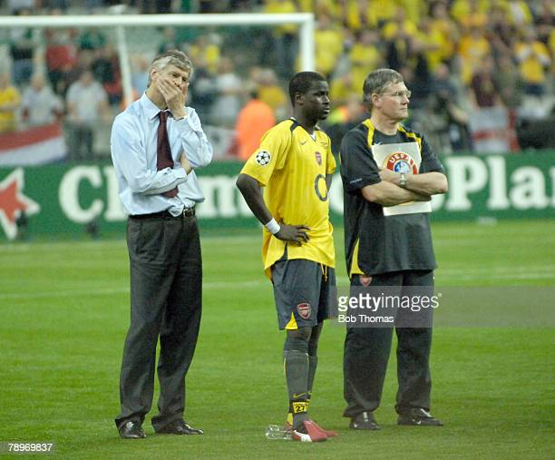 A dejected Arsenal manager Arsene Wenger stands on left with Pat Rice and Emmanuel Eboue after Arsenal lost 21 to Barcelona in the 2006 UEFA...