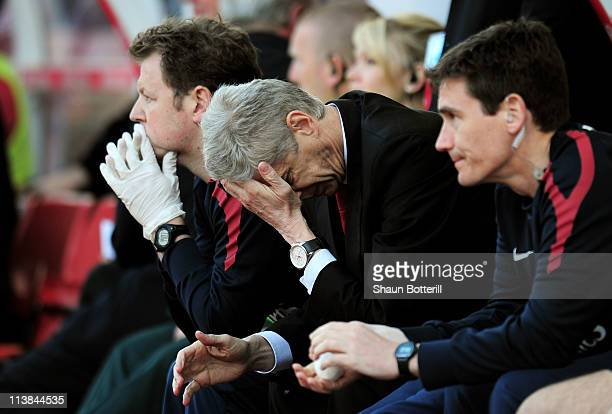 A dejected Arsene Wenger the Arsenal manager holds his head in his hands as his team head towards a 31 defeat during the Barclays Premier League...