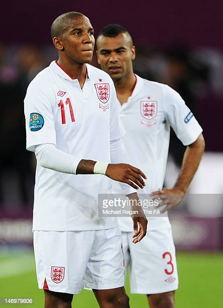 Dejected Ashley Young and Ashley Cole of England after they both missed penalties in a shootout during the UEFA EURO 2012 quarter final match between...