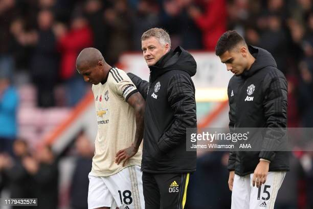 A dejected Ashley Young of Manchester United and Manchester United manager / head coach Ole Gunnar Solskjaer and Andreas Pereira of Manchester United...
