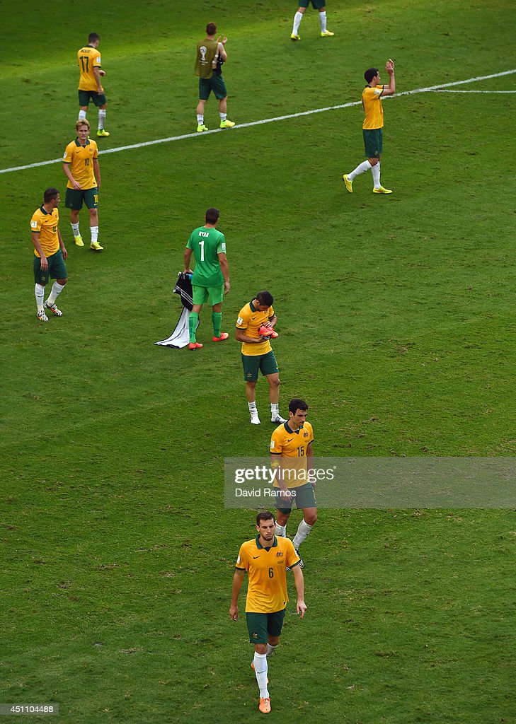 A dejected Australia look on after being defeated by Spain 3-0 during the 2014 FIFA World Cup Brazil Group B match between Australia and Spain at Arena da Baixada on June 23, 2014 in Curitiba, Brazil.