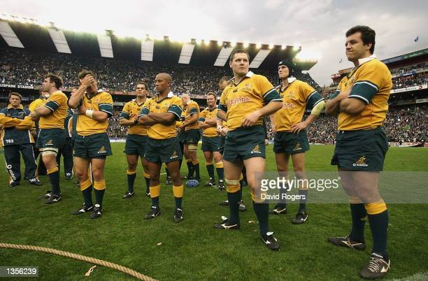 A dejected Australian team after losing to a last minute try and conversion by South Africa's Werner Greeff during the Tri Nations Rugby Union...