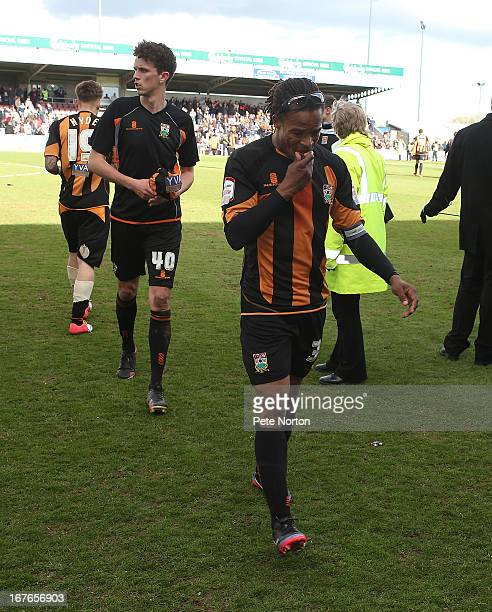 A dejected Barnet player/manager Edgar Davids leaves the pitch at the end of the match after defeat ensured relegation from the Football League...