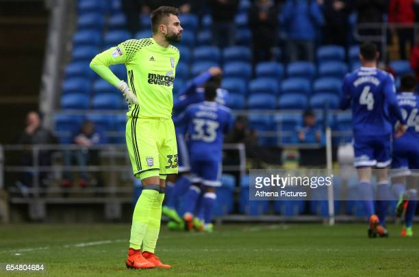 A dejected Bartosz Bialkowski of Ipswich Town looks on as Kenneth Zohore of Cardiff City celebrates scoring his sides first goal of the match during...