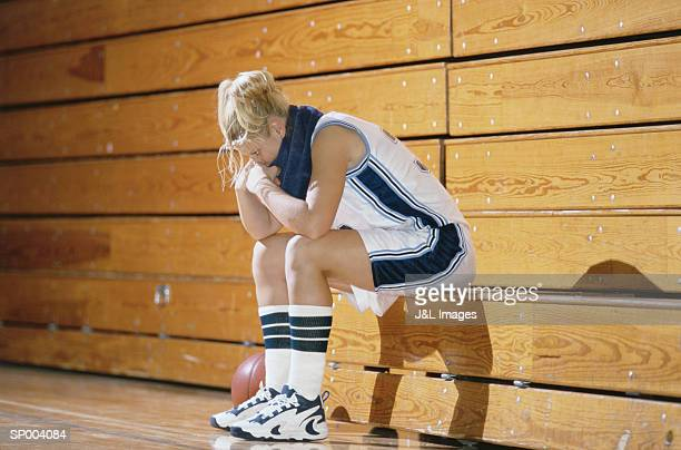 dejected basketball player - reserve athlete stock pictures, royalty-free photos & images