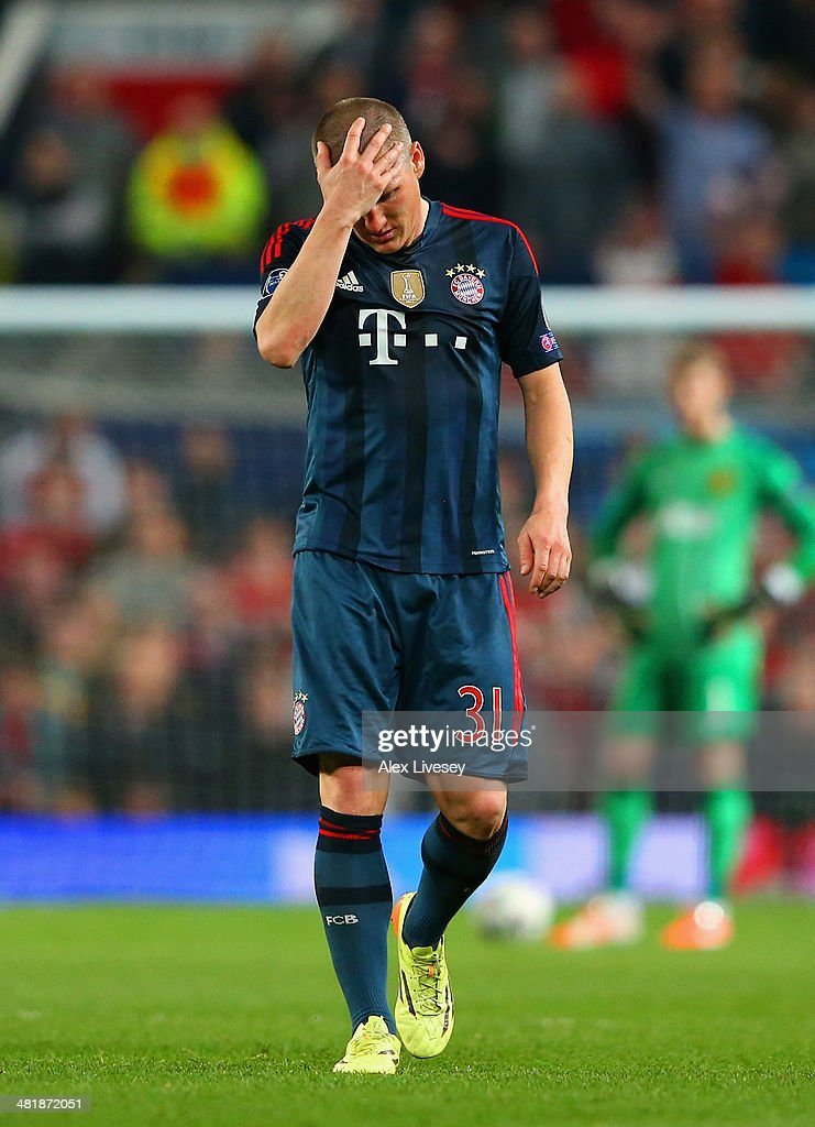 A dejected Bastian Schweinsteiger of Bayern Muenchen holds his head after he was shown a red card during the UEFA Champions League Quarter Final first leg match between Manchester United and FC Bayern Muenchen at Old Trafford on April 1, 2014 in Manchester, England.