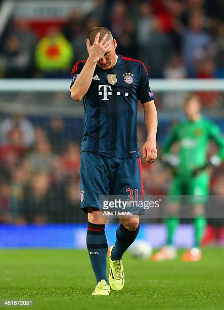 A dejected Bastian Schweinsteiger of Bayern Muenchen holds his head after he was shown a red card during the UEFA Champions League Quarter Final...