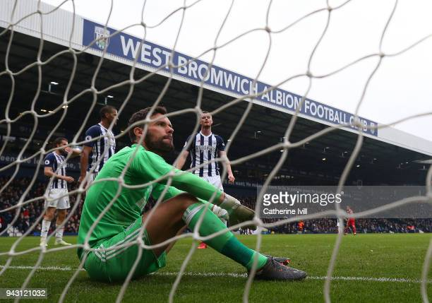 A dejected Ben Foster of West Bromwich Albion sits in the goal after Tammy Abraham of Swansea City scores his sides first goal during the Premier...