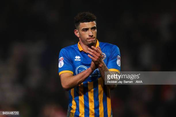 A dejected Ben Godfrey of Shrewsbury Town applauds the fans at full time during the Sky Bet League One match between Bradford City and Shrewsbury...