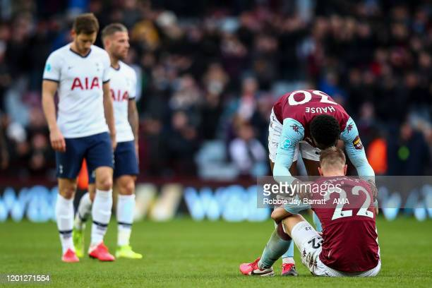 Dejected Bjorn Engels of Aston Villa is consoled by Kortney Hause of Aston Villa at full time during the Premier League match between Aston Villa and...