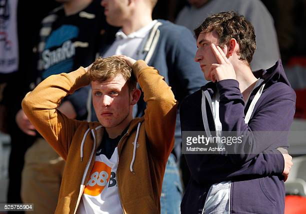 Dejected Bolton Wanderers fans after the final whistle and relegation from the Premiership