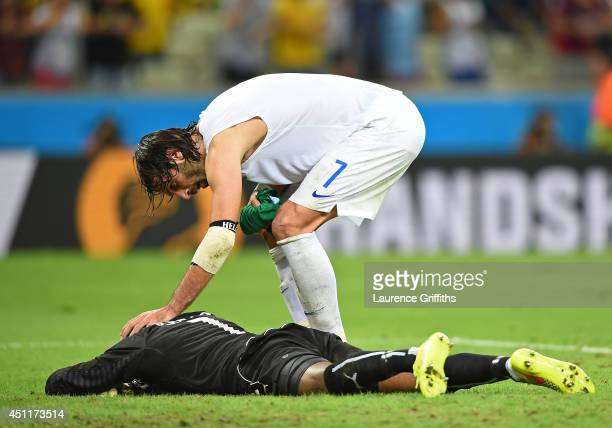 A dejected Boubacar Barry of the Ivory Coast is consoled by Giorgos Samaras of Greece during the 2014 FIFA World Cup Brazil Group C match between...
