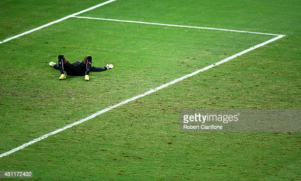 A dejected Boubacar Barry of the Ivory Coast lies on the field after being defeated by Greece 21 during the 2014 FIFA World Cup Brazil Group C match...