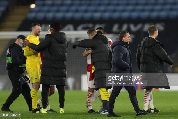 Dejected Brendan Rodgers the manager / head coach of Leicester City walks past players of Slavia Prague celebrating at full time during the UEFA...