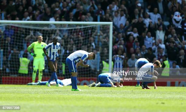 Dejected Brighton & Hove Albion players react after Jack Grealish of Aston Villa scored a goal to make it 1-1 during the Sky Bet Championship match...