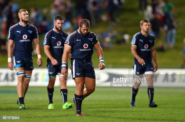 Dejected Bulls players leave the field after the round five Super Rugby match between the Blues and the Bulls at Eden Park on March 25 2017 in...