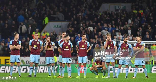 A dejected Burnley's James Tarkowski with his team mates after missing his penalty during the Carabao Cup Third Round match between Burnley and Leeds...