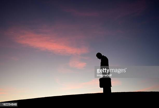 dejected businessman silhouette - bad posture stock pictures, royalty-free photos & images