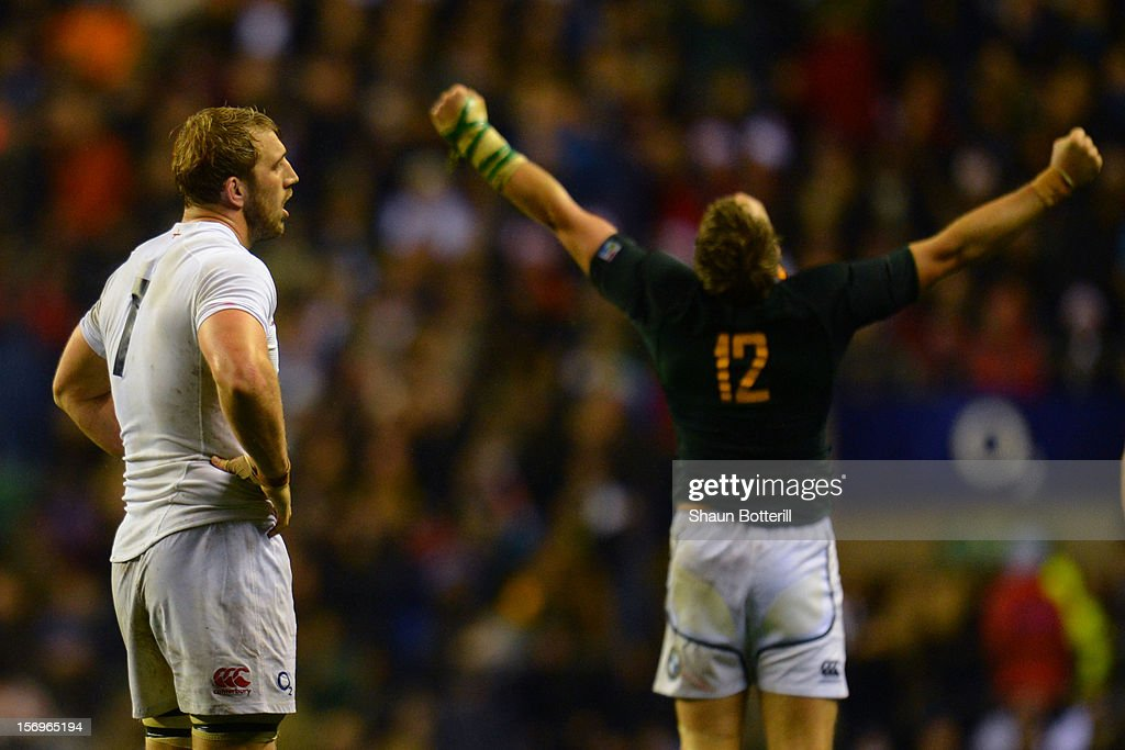 Dejected captain Chris Robshaw of England looks on as Jean de Villiers of South Africa celebrates victory during the QBE International match between England and South Africa at Twickenham Stadium on November 24, 2012 in London, England.