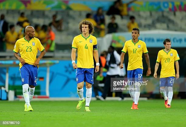 A dejected captain David Luiz of Brazil alongside team mates Maicon Luiz Gustavo and Bernard of Brazil