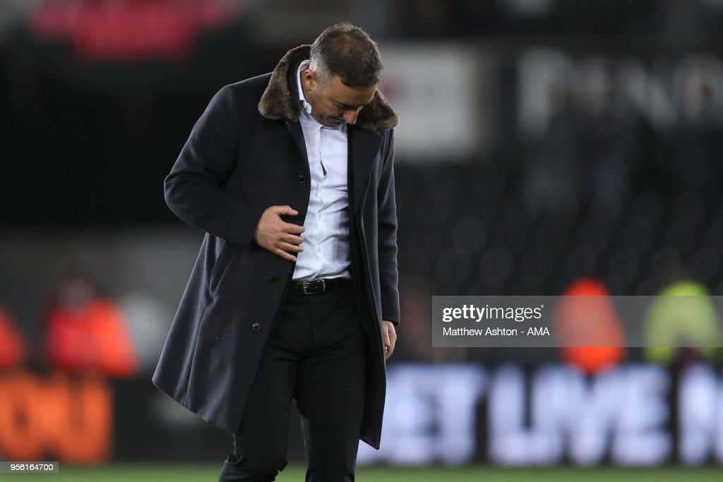 A dejected Carlos Carvalhal head coach / manager of Swansea City at full time during the Premier League match between Swansea City and Southampton at Liberty Stadium on May 8, 2018 in Swansea, Wales.
