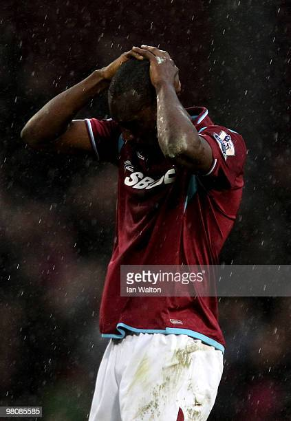 A dejected Carlton Cole of West Ham reacts after his team lose 10 during the Barclays Premier League match between West Ham United and Stoke City at...