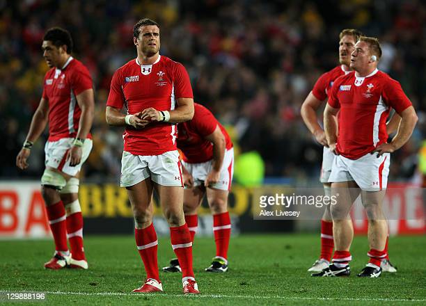Dejected Centre Jamie Roberts of Wales and teammates look on following their team's 1821 defeat during the 2011 IRB Rugby World Cup bronze final...
