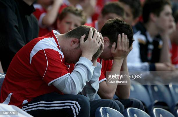 Dejected Charlton Athletic fans hold their heads during the Barclays Premiership match between Blackburn Rovers and Charlton Athletic at Ewood Park...